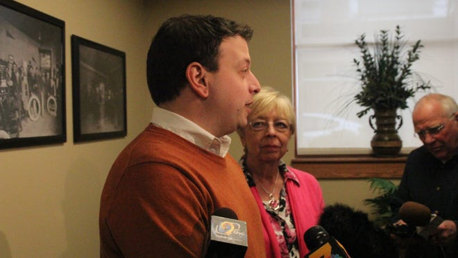 Matt Sinovic (left), executive director of Progress Iowa, addresses reporters about Sen. Chuck Grassley's recent comments about appointing a successor to Supreme Court Justice Antonin Scalia prior to Grassley's town hall meeting Tuesday, Feb. 16, at the Marengo Public Library. With Sinovic is Sue Dinsdale, executive director of Iowa Citizen Action Network.