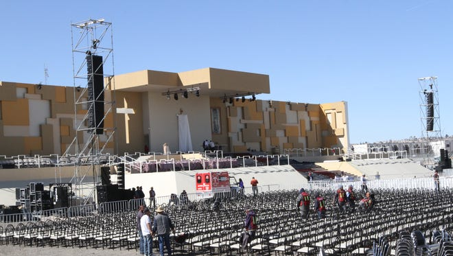 Workers set up chairs in front of the altar in preparation for Pope Francis' celebration of Mass in February in Juárez.
