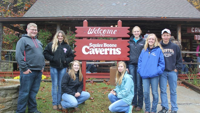 FFA Members attended the National FFA Convention and visited Squire Boone Caverns as one of many tour stops. From left are Kip Grotegut, Camryn Braun, Sanne de Bruijn, Maddie Zutz and Joe Litz. Kneeling in front, from left, is Bailey Goehring and Abby DeMeyer.