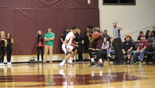ULM's DeMondre Harvey prepares to drive to the basket against Texas State.