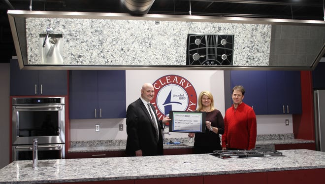 From left, Cleary University President Jason Boyers, Livingston Daily Director of Sales & Marketing Jani Hayden, and Livingston Daily Managing Editor Jim Totten presenting Cleary University with $6,000 from the Gannett Foundation toward its community kitchen.