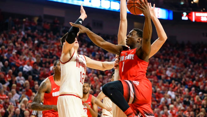 Ohio State's Jae'Sean Tate (1) goes for a layup against Nebraska's Michael Jacobson (12) during the second half Saturday. Ohio State won 65-62 in overtime.