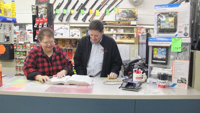 Mark Swift, right, owner of Brown's True Value, talks with Patsy Imhoff, store employee.