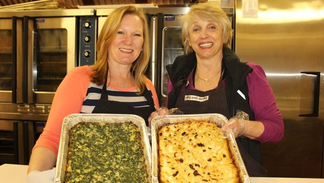 Kelly Capouya, left, and Jennifer Ives hold popular dishes that will be sold at Sunday's annual Jewish Food Festival at Temple Beth Or.