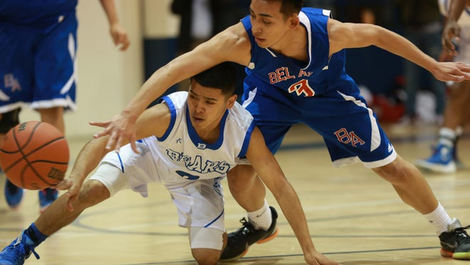 Bel Air's Sergio Enriquez, right, and Bowie's Bobby Lerma scramble for a loose ball during the second quarter Tuesday at Bowie.