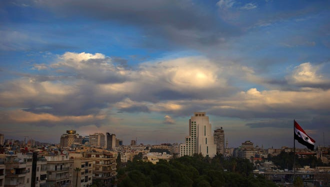 Clouds hover over the Syrian capital, Damascus, Thursday, Feb. 25, 2016.
