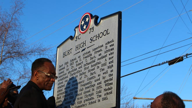 Jackie Collins, left, stands next to a historical marker recognizing the significance of the former Burt High School, Sunday, Feb. 28, 2016.
