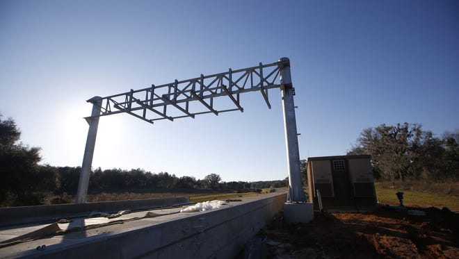 The single toll gentry for Orchard Pond Parkway — the first privately built toll road in Florida, is seen here under construction on Thursday, Feb. 25, 2016. The toll road is set to open in early April of this year.