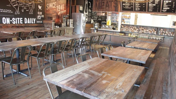 Dickey's Barbecue Pit is lined with chalkboard walls that share the history of the restaurant.
