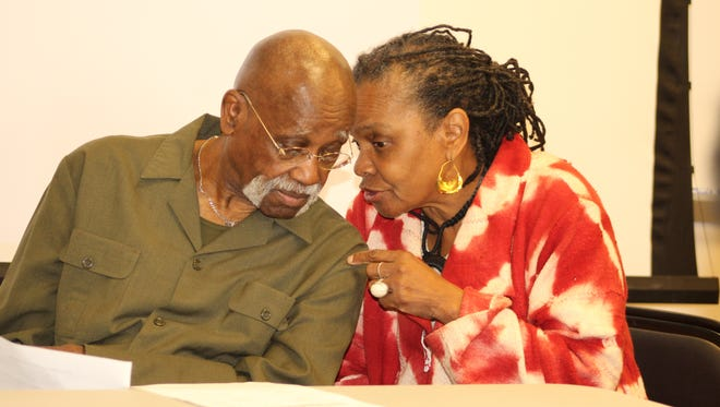 Faya Rose Toure confers with Leonard Dunston during Friday's education summit at Wallace Community College in Selma.