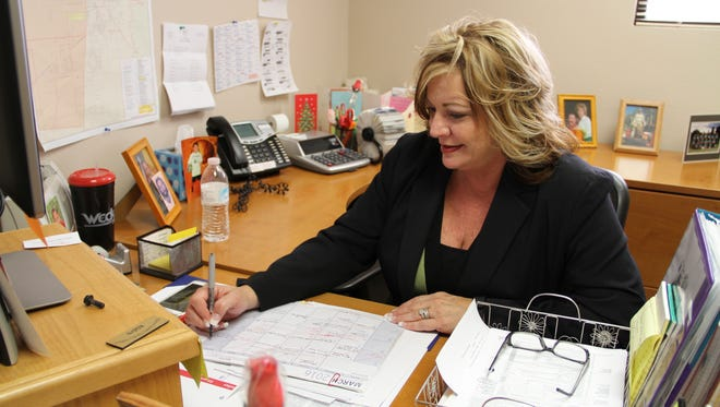 Chief Deputy Clerk Robyn Holmes sits in her office on filing day. Holmes will be running for Otero County Clerk.