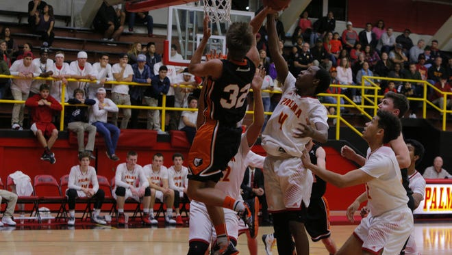 Palma High's Jamaree Bouyea blocks the shot of a Summerville player during the first half of Wednesday's game.