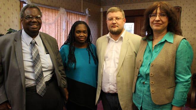 State Sen. Hank Sanders, left and his daughter Malika Sanders Fortier meet Russian lawyers Sergey Panchenko and Tatiana Demicheva.