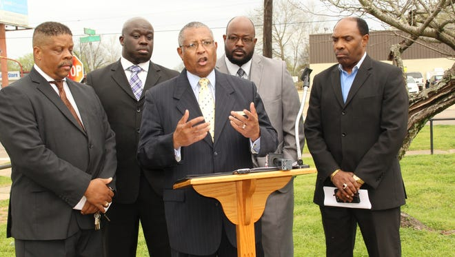 The Rev. James Perkins Jr., center, was joined by Revs. Reginald Wells, Labarron Thomas, Kerry Horton and Effell Williams in an effort to focus on an increase in violence in Selma.
