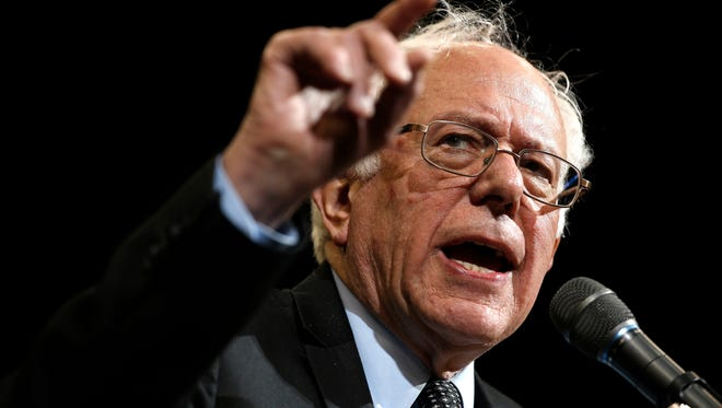 The two political parties can't cover the diversity of thought among American voters, an op-ed writer says. Democratic presidential candidate Bernie Sanders, shown during a campaign stop March 13 at Ohio State University, appeals to many young and poor people with his brand of socialism, but not so much the middle class.