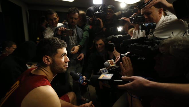 Iowa State forward Georges Niang talks with members of the media Friday, March 18, 2016, following their closed practice session at the Pepsi Center in Denver.