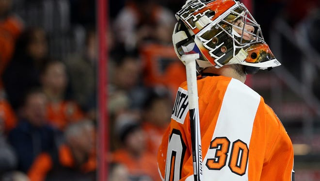 "Goalie Michal Neuvirth will miss the next three weeks with a ""lower-body injury."""
