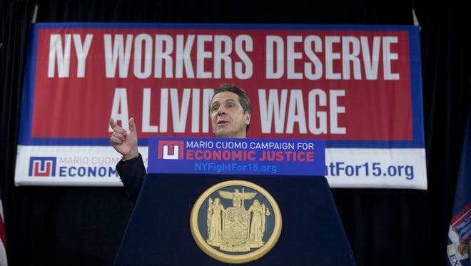 Gov. Andrew Cuomo speaks in Albany during a February 2016 rally to support raising the minimum wage. Now, Cuomo is talking about eliminating the tipped wage for workers and increasing their pay to be on par with the minimum wage.
