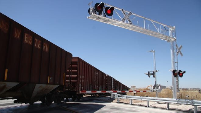 A train makes its way across the new tracks laid at U.S. Highway 281 and State Road 31.