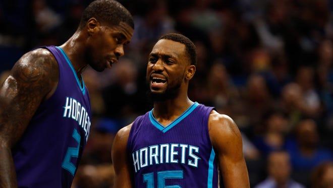 Charlotte Hornets guard Kemba Walker and forward Marvin Williams  talk against the Orlando Magic.