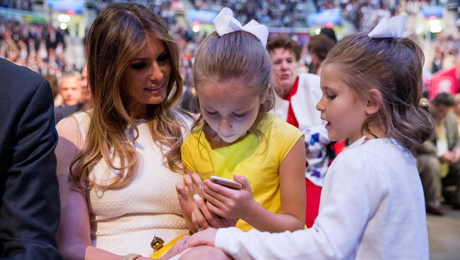 The daughters of Republican presidential candidate Sen. Ted Cruz, Catherine, right, and Caroline, center, visit with Donald Trump's wife, Melania Trump, left, during a commercial break in the Republican presidential debate in Cleveland. If the prospect of first lady Melania Trump evokes no clear image, that's no accident. Melania Trump has said little in the campaign about the type of first lady she'd like to be should her husband win the Republican nomination and the presidency. (AP Photo/Andrew Harnik, File)