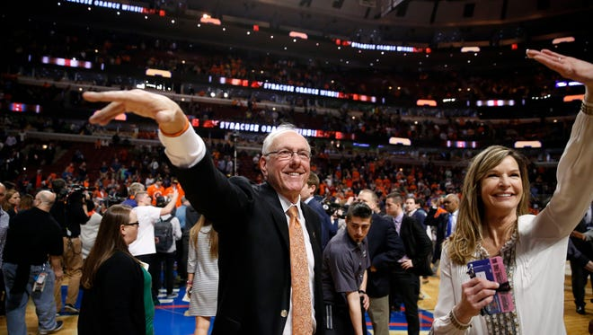 Syracuse basketball coach celebrates reaching the Final Four last weekend, with his wife, Juli.