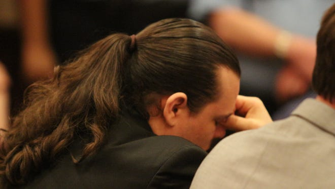 """Matthew Reynolds reacts Friday after finding out that a jury convicted him of premeditated first-degree murder and especially aggravated kidnapping in the 2014 beating death of """"house slave"""" Shirley Beck."""