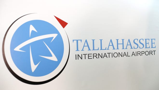 The new Tallahassee International Airport logo is revealed during the designation announcement at the airport on Monday, June 29, 2015.