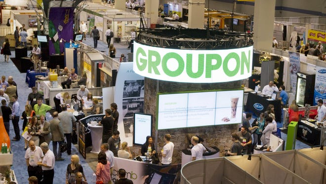 IMAGE DISTRIBUTED FOR GROUPON - Groupon booth is seen at the National Restaurant Association Tradeshow at McCormick Place, on Sunday, May 19, 2013 in Chicago.  Groupon highlights the company's marketing and Breadcrumb by  Groupon point-of-sale and payments at the tradeshow. (John Konstantaras / AP Images for Groupon) ORG XMIT: CPA104 [Via MerlinFTP Drop]