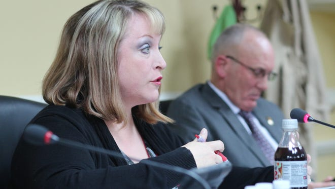 Councilwoman Deanna McLaughlin discusses the proposed liquor store ordinance at Thursday's City Council meeting. McLaughlin proposed the ordinance that would increase the number of stores in the city.
