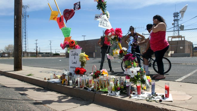 Friends visit the vigil site for Loreal Tsingine, who was shot and killed by Winslow police Officer Austin Shipley on March 27.