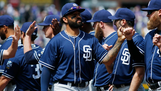 Padres right fielder Matt Kemp is welcomed to the field by teammates.