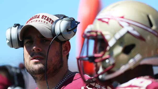 Sean Maguire (10) looks on from the sidelines during the Florida State spring game at the Citrus Bowl.