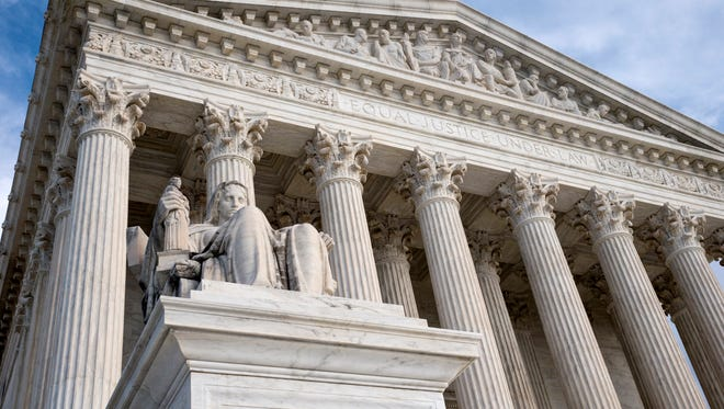 FILE  - The Supreme Court in this Feb. 17, 2016 file photo. An Associated Press-GfK poll shows that nearly 2 in 3 Americans back Democrats' demands that the Republican-run Senate hold hearings and a vote on President Barack Obama's pick for the Supreme Court.