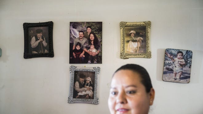 Herlinda Calderon, 40, and her husband Oscar Armando Lopez, 44, are undocumented migrants from Mexico. They live in Phoenix with children Oslin, 8, Ramon, 6 and Kimberly, 2, who were born in U.S., making her eligible to apply for President Obama's deferred action program for undocumented parents of U.S. citizens and legal residents.  Herlinda Calderon is one of an estimated 3.6 million undocumented immigrants with children who are either U.S. citizens or legal residents who would qualify for work permits and protection from deportation under President Obama's 2014 executive actions on immigration.  Calderon went to Washington, D.C., to join thousands of others from around the country in hopes of putting pressure on the Supreme Court to allow Obama's program to be implemented. The program was put on hold by a U.S. district court judge in Texas in February 2015 after Texas and 25 other states, including Arizona, filed a lawsuit challenging the legality of the program.