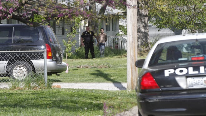 The suspect being escorted by police.