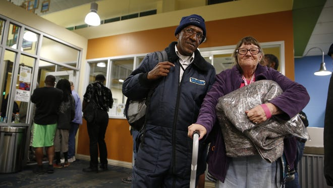 Emory Cooper and Kathy Arnold wait to check in for the night at the Kearney Center where there is a strict 8pm cutoff for people hoping to spend the night, though people just being released from jail are able to stay in the lobby if they are not allowed into the dorm room facilities. The Leon County Sherriff's department will occasionally drop off people directly after they are released, if they don't have a home to go to.