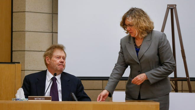 Johnson County Attorney Janet Lyness speaks with Dr. Arnold Andersen during testimony on Friday, April 22, 2016, at the Story County Courthouse in Nevada. Trial resumed Friday in the first-degree murder charge against Alexander Kozak, who has been charged in the shooting death of Andrea Farrington.
