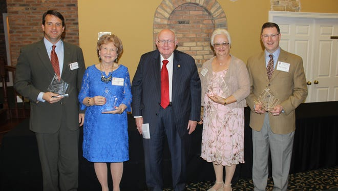 William Carey University inducted four alumni into the Hall of Fame on April 8. Pictured after the induction ceremony are, from left, Alan K. Sudduth of Pascagoula; Mary Strebeck Morton of Mobile, Alabama; Tommy King, William Carey University president; Rose Lavern  Rainey of Tupelo; and Terry R. Tinsley of Gainesville, Virginia.