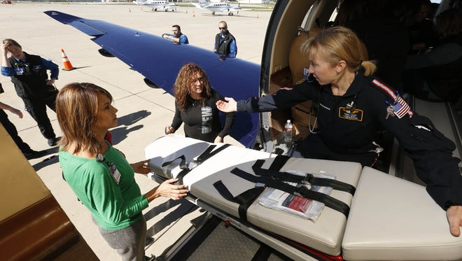 From left, flight nurses Katy Hill and Tina Baysinger of UnityPoint Health in Des Moines listen as Sherri Steffens, a flight nurse with Air Methods Corporation in Omaha, explains how to load a patient into the back of the Pilatus PC-12 fixed wing airplane in September 2015 at the Des Moines airport. About 20 medical professionals were trained on the features of the plane as UnityPoint began offering the service for neonatal, pediatric and adult patients requiring long distance emergency transport.