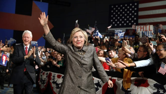 In this April 26 file photo, Democratic presidential candidate Hillary Clinton, accompanied by former President Bill Clinton walks to stage at her presidential primary election night rally in Philadelphia.