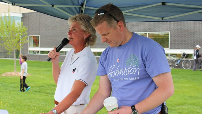 Cheryl Pannier, left, emcees Johnston's Kites on the Green. Co-director James Patten is shown at right.