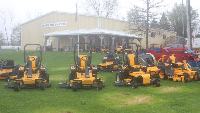 A large range of Cub Cadet lawn and garden equipment sits outside on display at Iowa Lawn and Garden. Sthil equipment will soon be coming as well.