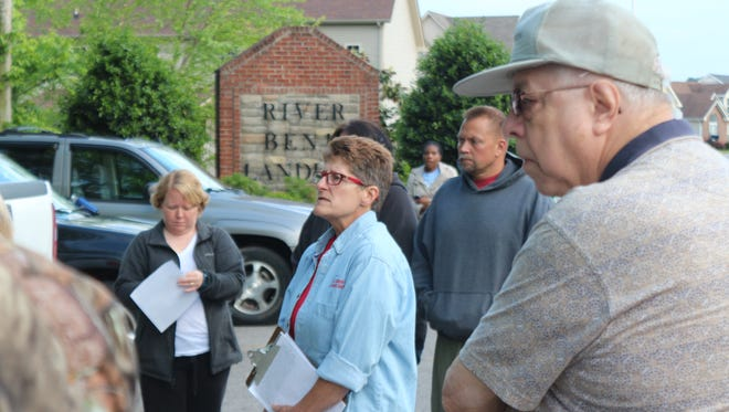 Pam Klomfas, center, talks to residents from the Powell Road area Tuesday night. The more than 20 residents who gathered outside the River Bend Landing subdivision are concerned with a potential rezoning of a property that would add more than 120 homes to the area.