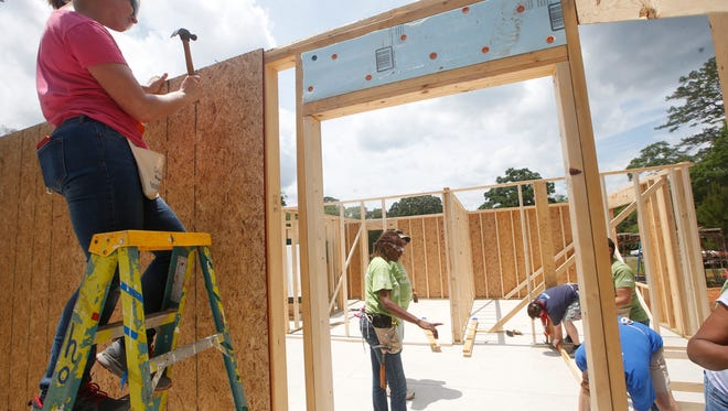 Tallahassee Democrat employees and other volunteers work Tuesday on a Habitat for Humanity house during Habitat's National Women Build Week, locally penned 'She Nailed it Blitz Week', where the nonprofit is asking for women volunteers to help build housing.