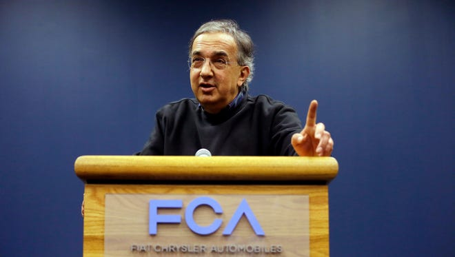 Fiat Chrysler Automobiles Chairman and CEO Sergio Marchionne addresses the media, Friday, May 6, 2016, in Windsor, Ontario. Fiat Chrysler and Google announced Tuesday, May 3, that they will work together to more than double the size of Google's self-driving vehicle fleet by adding 100 Chrysler Pacifica minivans. (AP Photo/Carlos Osorio)