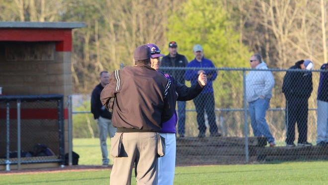 Clarksville High coach Brian Hetland talks to an ump during a baseball game earlier this year. The Wildcats dropped Northwest 12-2 in the district tournament Friday afternoon.