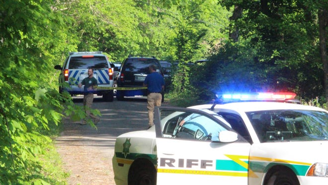Montgomery County sheriff's deputies put up caution tape at the end of Houston Road on Tuesday at the scene of a death investigation.