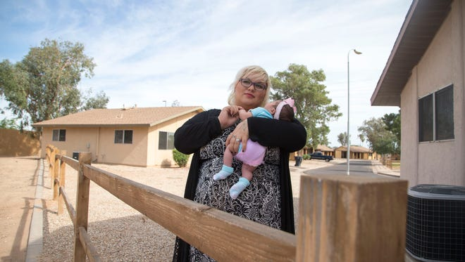 Several Valley transitional-housing providers recently found out they were losing the annual HUD grants that keep them operating. The cuts reflect a national shift away from intermediate housing options in favor of directly placing homeless people in permanent housing, a strategy HUD officials say is cheaper and more effective.  Mandi Boyster, lives in a unit with her 5-day-old girl, Shyloe, at House of Refuge in East Mesa.