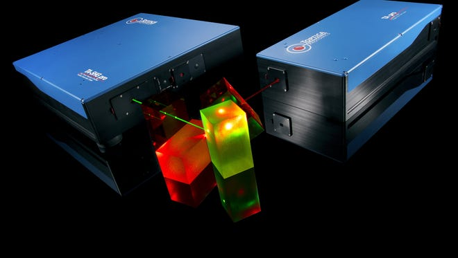 Two fiber lasers built by TOPTICA Photonics of Victor blast out green and red light onto optical prisms.